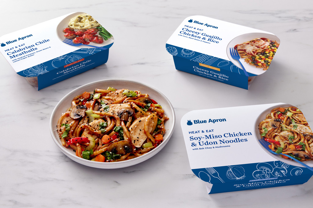 Three trays of Blue Apron meals and a bowl of Asian noodles